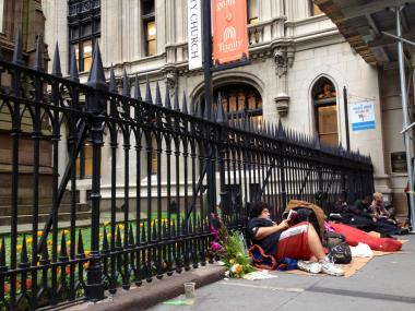 Trinity Church has canceled its Halloween program, citing safety concerns over a sidewalk encampment.