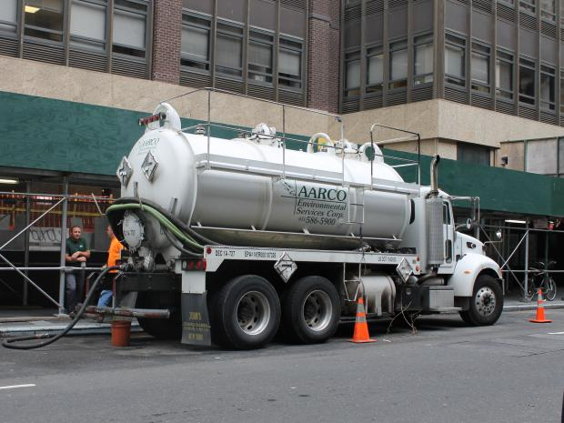 A contractor was fined after officials found it dumping oil and water into city sewers.