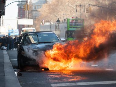 A car caught fire outside of 233 Broadway on Monday, Nov. 26. No one was injured, according to the FDNY.