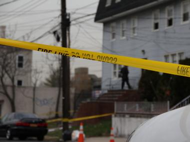 Two men were shot, one killed, when gunfire erupted at 73 Bodine St. on Friday November 30, 2012, cops said.