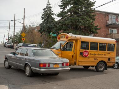 A mini school bus with children on board travelling northbound on 64th Street in Queens collided with a grey Mercedes Benz travelling eastbound on 62nd Avenue on Nov. 20, 2012.
