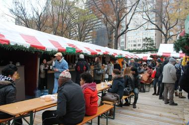 Market-goers enjoy hot food at the annual Columbus Circle market.
