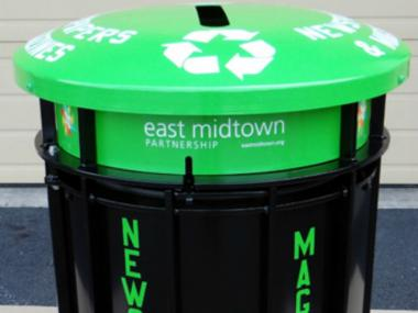 The East Midtown Partnership has placed 21 paper-only recycling bins around the district.