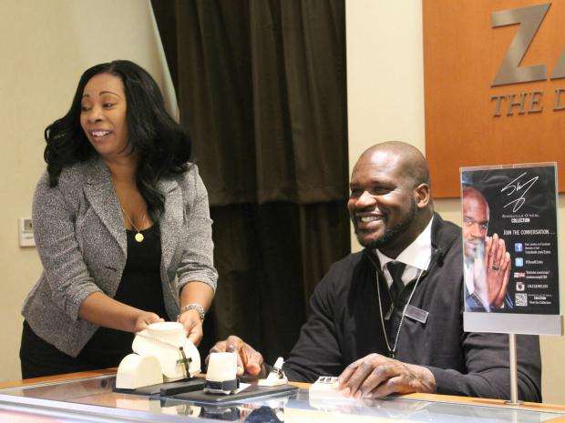 The basketball giant showed off his new line of jewelry at the Zales store on Fifth Avenue on Monday.
