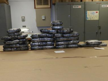 Cops seized more than 100 pounds of cocaine from traffickers transferring the drugs out of the Crowne Plaza Hotel in Times Square.