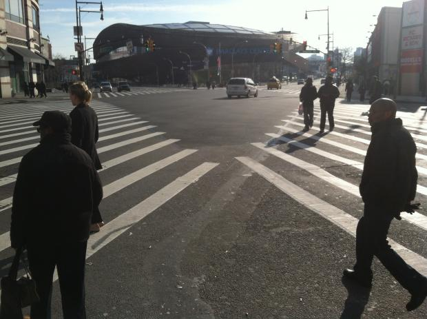 A pedestrian was fatally struck by a street sweeper in front of the Barclays Center early Saturday morning.