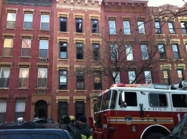 The blaze broke out at 410 E. 120th St., a four-story residential building, according to the FDNY.
