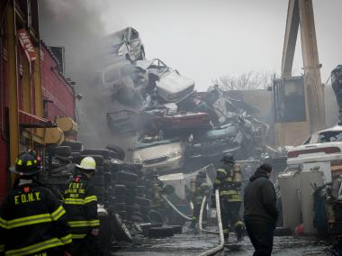 Over 130 firefighters rushed to Jamaica, Queens, to battle a massive junkyard fire on Monday December 17, 2012.