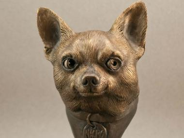 Gary Oshust will whittle clay and resin into images of people's pets for a commission.