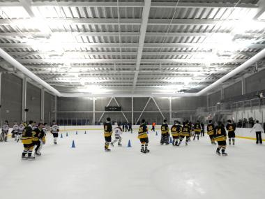Hockey players skate in the World Ice Arena in Flushing, Queens.