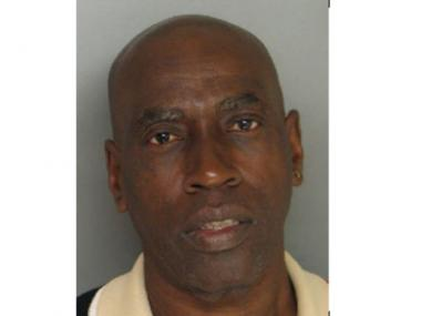 Lucius Crawford, 60, was arrested Wednesday, Dec. 5, 2012, after police found a dead woman in his bed.