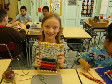 Fifth-grade teacher Annmarie Aquino shares her passion for knitting with her students.
