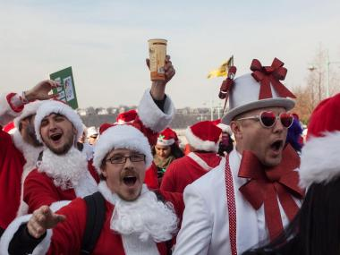 Santas cheer on Pier 84 during Santacon 2012.