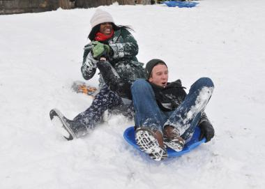 Teens sled down hills in Brookyn's Fort Greene Park.