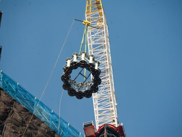 The first piece of the spire that will top off One World Trade Center was hoisted to the roof Wednesday, in a process that took about 45 minutes.