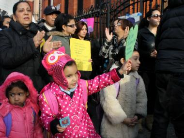 Students and families rallied Wednesday to save two Bronx Catholic schools the Archdiocese may close.