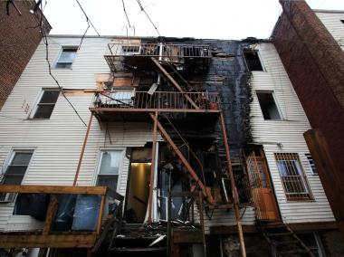 Flames climbed up the rear of 3167 Villa Ave. and tore through the top floors, injuring three—a woman and a child seriously—on Friday December 21, 2012.