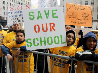 Students and families rallied Wednesday, Dec. 12, 2012 to save two Bronx Catholic schools the Archdiocese of New York may close.