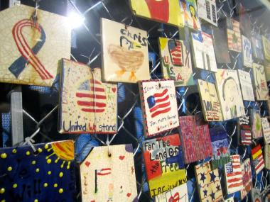 The 9/11 memorial tiles once hung on a fence on Seventh Avenue South can now be found at the Jefferson Market Library on Sixth Avenue near West 10th Street.