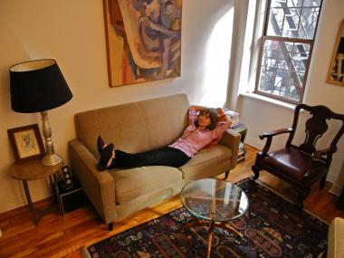 DNAinfo Contributor Elizabeth Wolff stretches out on her own tiny couch.