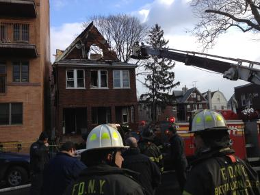 A raging fire engulfed a Brooklyn home Friday morning, Jan. 4, 2013, leaving six people injured and as many as 17 residents homeless, FDNY and American Red Cross officials said.