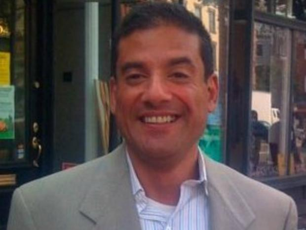 Charles Romo, 48, was beaten to death in his Harlem apartment, police sources said.