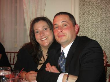 Gina Schindler with her husband, Officer Matthew Schindler. A lawsuit claims Officer Schindler killed himself because a female supervisor forced him to have sex with her.