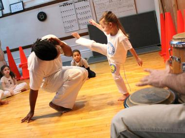 The New York City Capoeira Center holds classes for capoeira, a martial art that is disguised as a dance.