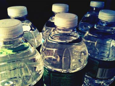 Poland Spring water bottles, in a creative photograph. Police arrested two men for stealing 35 cases of the water from a Hurricane Sandy relief outpost on January 25, 2013.