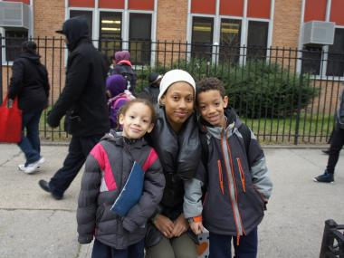 Mom Sierra Tarver and two of her children outside P.S. 262 in Bedford-Stuyvesant. Although the elementary school is one of the best-performing in the district, Tarver said she is still looking for a better match for her kids.