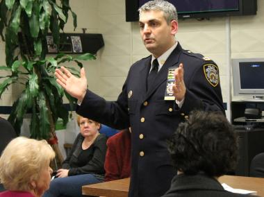 Captain Thomas Conforti, who oversees the 112th Precinct, at a recent community council meeting