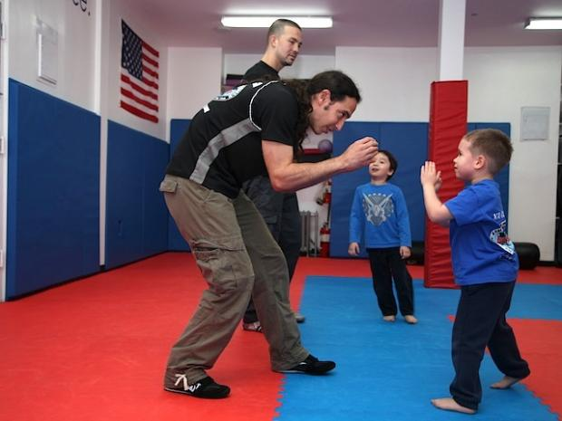 Kids learn defensive tactics and moves at Krav Maga International's after-school program on the Upper West Side.