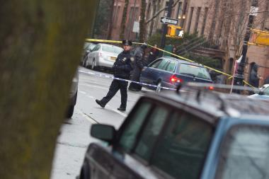 An officer watches the intersection of Clinton St. near Sackett St. in Brooklyn where Elizabeth Borst was found with a head wound on Feb. 22, 2013.
