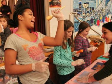 Sixth graders sold fruits and vegetables after school as part of a health class program.
