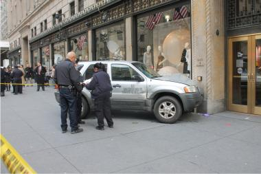 An SUV collided with a panel truck and careened into a crowd of pedestrians on Fifth Avenue late Tuesday morning, Feb. 12, 2013, slamming into an elderly man before coming to a stop outside Saks Fifth Avenue, the FDNY and witnesses reported.