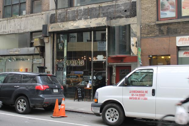 A new landlord took over the building and brought down scaffolding blocking Spring from the street.