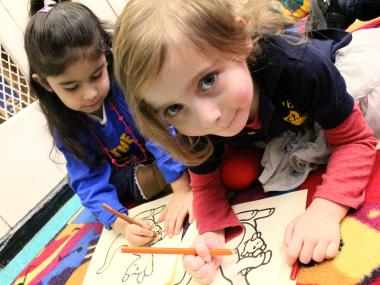 Students color during a pre-K class in the S.T.A.R Academy in the East Village.