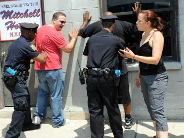 Cops frisk two men in stop-and-frisk training in the Bronx.