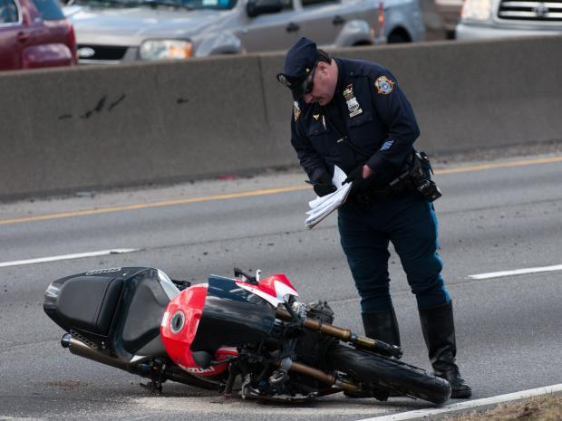 A motorcycle struck a woman crossing the Belt Parkway on foot early on March 26, 2013.