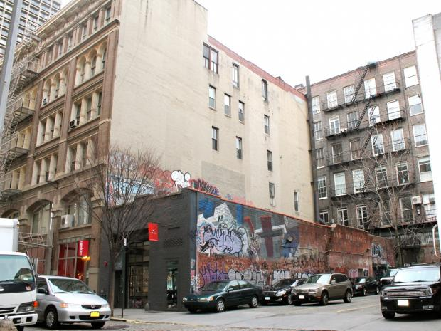 An artist and longtime SoHo resident has sued the city to try to stop the construction of an eight-story building on her block of Wooster Street.