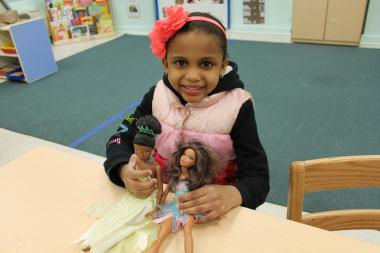 "Georgia Braithwaite, 4, says she likes Barbies of color because ""They look like me,"" she said."