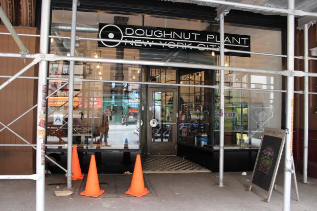 A lawsuit claims a blind man fell into an open, unmarked street elevator shaft outside of the Doughnut Plant.