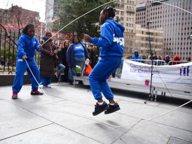 Girls from the Sports & Arts in Schools Foundation do Double Dutch for a rally against budget cuts in 2013. New York City was the first school district in the country to offer competitive Double Dutch as a varsity sport.