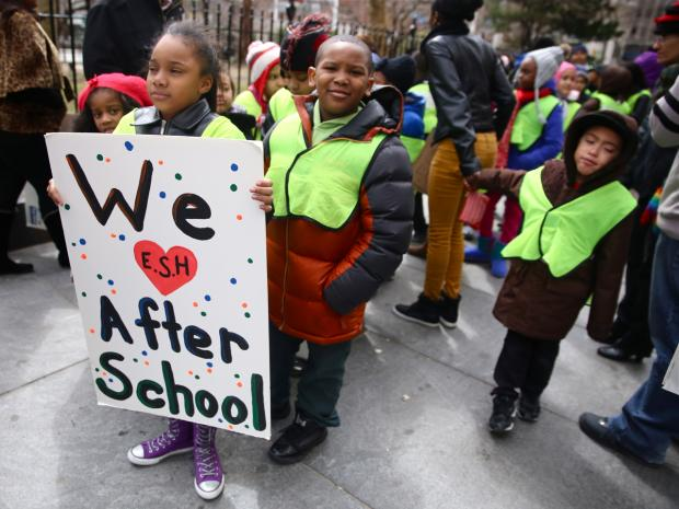 Afterschool program participants rally against proposed budget cuts.