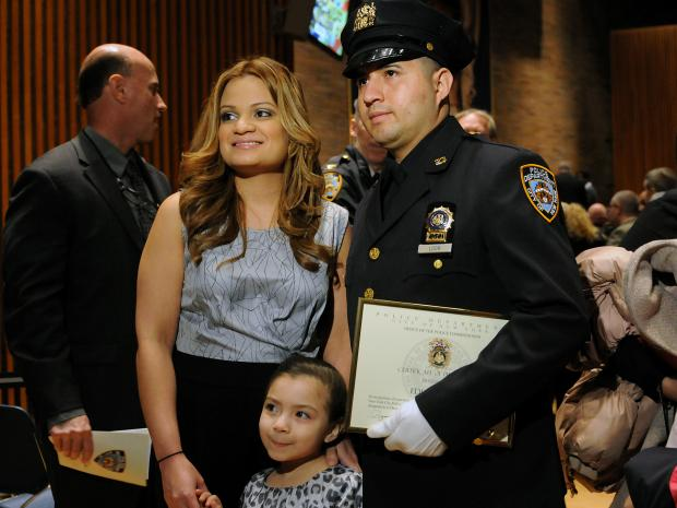 Officer Eder Loor, 29, was promoted to detective at a ceremony at One Police Plaza Friday, nearly one year after he was stabbed in the head by an emotionally disturbed man in East Harlem, March 1, 2013.