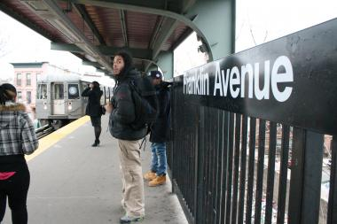 Passengers wait for the Franklin Avenue shuttle. The MTA denied a renovation of the station on Fulton Street in the latest budget negotiations.