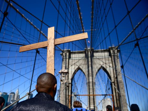 The Way of the Cross is a traditional Catholic procession that recalls the suffering and death of Jesus. The procession begins at St. James Cathedral in Downtown Brooklyn and ends at St. Peter's Church on Barclay Street.
