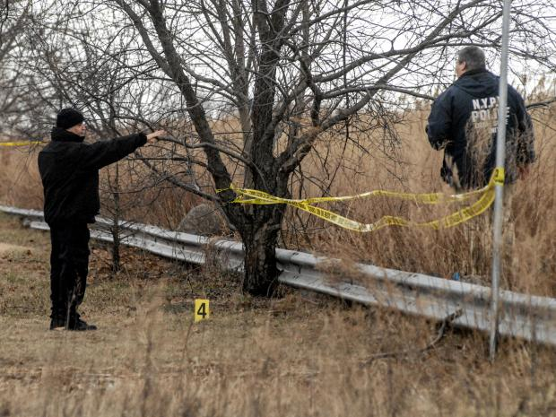 Police look for evidence at a Howard Beach Crime Scene in the marsh near 159th Ave. and 79th St.