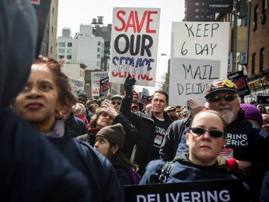 A rally to rescue six-day delivery takes place outside the James A. Farley Post Office on Mar. 24, 2013.
