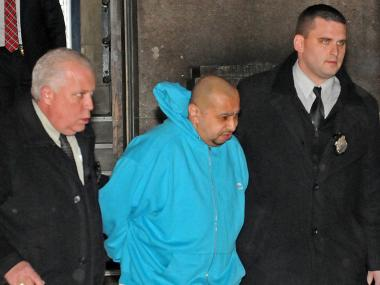 Julio Acevedo, 44, was walked out of the 78th Precinct on his way to Brooklyn Criminal Court March 7, 2013 to face charges for fleeing the scene of a fatal hit-and-run crash in Williamsburg.